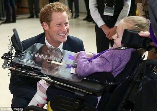 Prince Harry talks with charity recipient